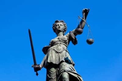 demonstrative evidence lady justice scale sword